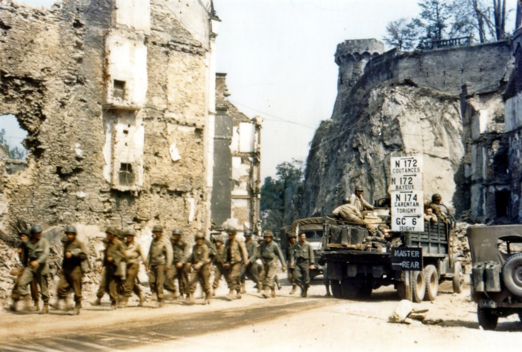 colour photo of us troops marching through western saint l. Black Bedroom Furniture Sets. Home Design Ideas